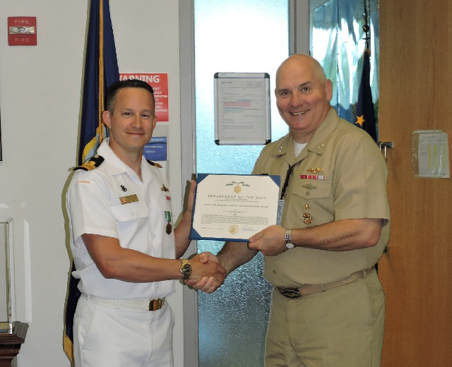 LCdr Craig Piccolo receives award